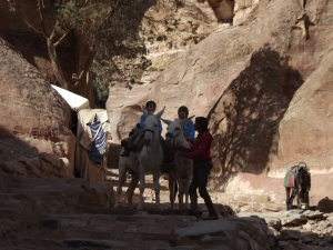 this is me and my brother riding a donkey in Petra