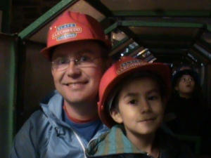 Me and boys digging a Welsh Slate mine while mom put her feet up in front of the fire