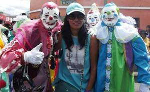 Lore posing with some clowns during a dancing break